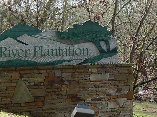masonry sign for the River Plantation community
